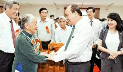PM Phuc calls for better care for national contributors