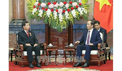 President Tran Dai Quang receives Lao supreme court chief