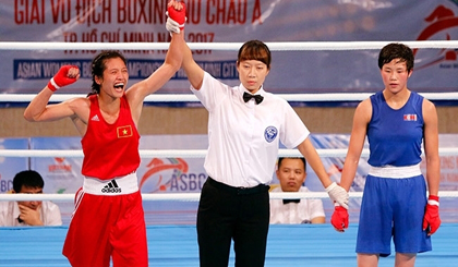 Nguyen Thi Tam wins a gold medal Vietnam in the 51kg weight category at the Asian Women's Boxing Championships 2017.