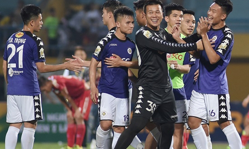 Hanoi FC players celebrate with joy. (Photo: NDO/Tran Hai)