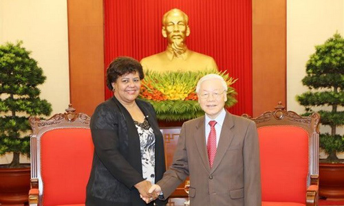 CPV General Secretary Nguyen Phu Trong (R) and Secretary of the CPC Central Committee Olga Lidia Tapia Iglesias (Source: VNA)
