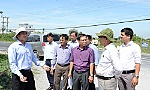Chairman of the PPC Le Van Huong checks the basic construction works